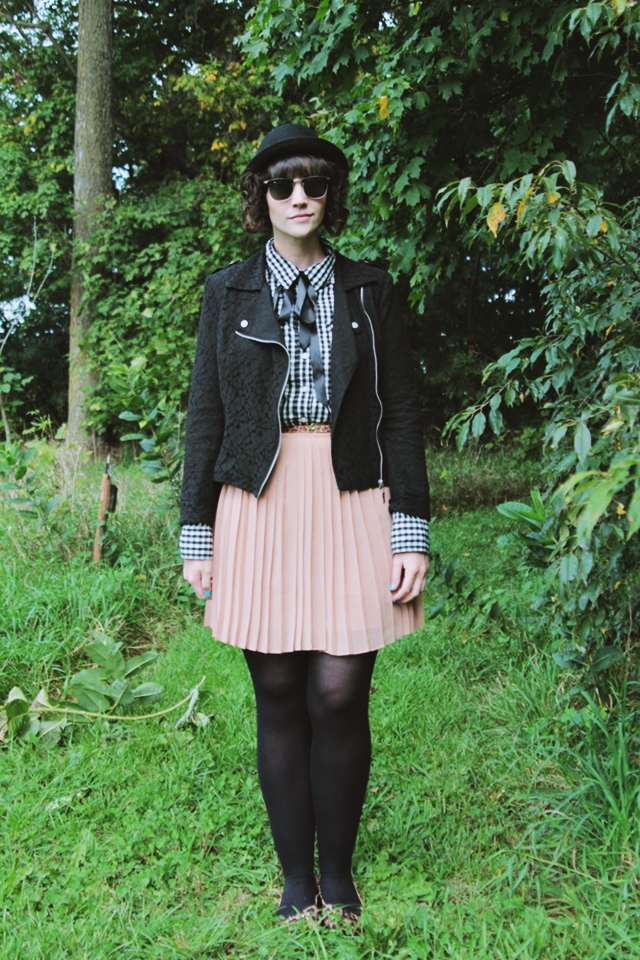 Outfit: Gingham top, blush pleated skirt, and lace moto jacket.