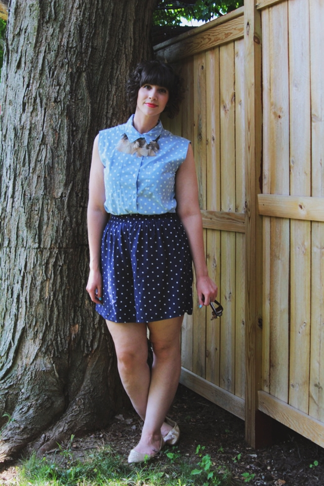 Outfit: Blue polka dot top, matching shorts, DIY feather necklace.