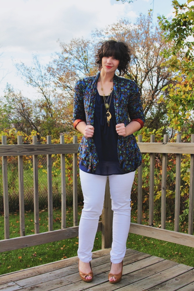 Outfit: Blue floral blazer, white jeans, and curly Carly Rae Jepsen hair.