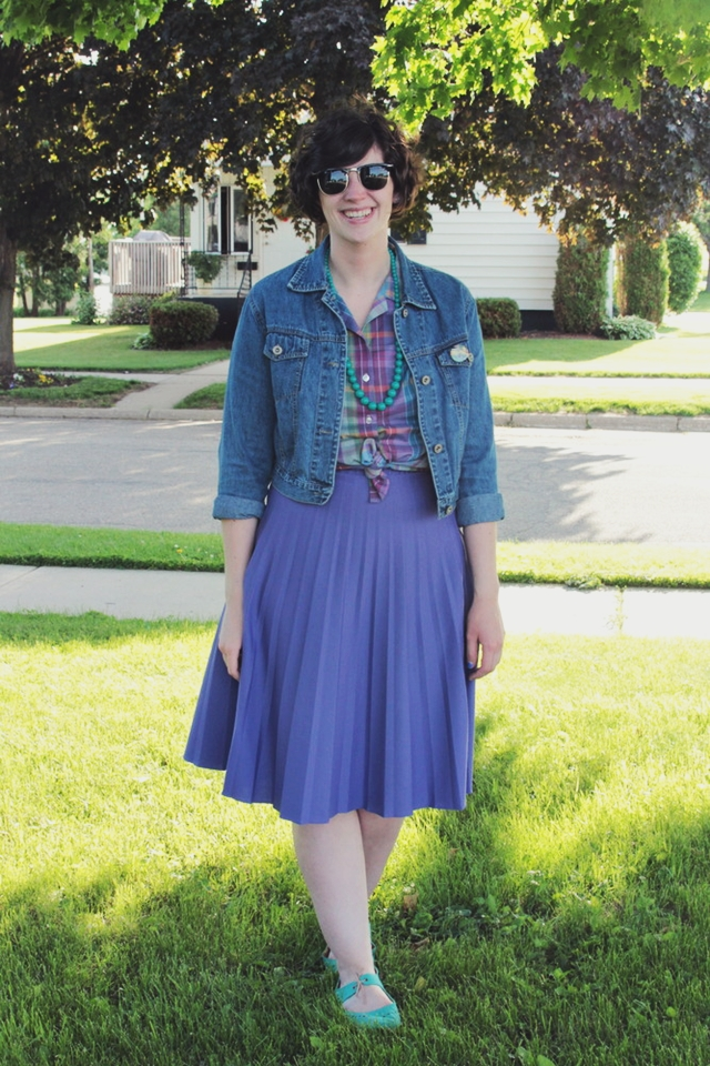 Outfit: Purple skirt, matching plaid top, vintage pins on denim jacket.