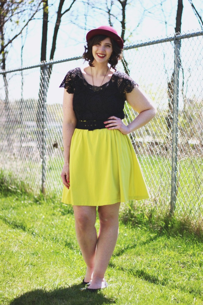 Charturese skirt, black top, purple bowler hat. A cute spring outfit!