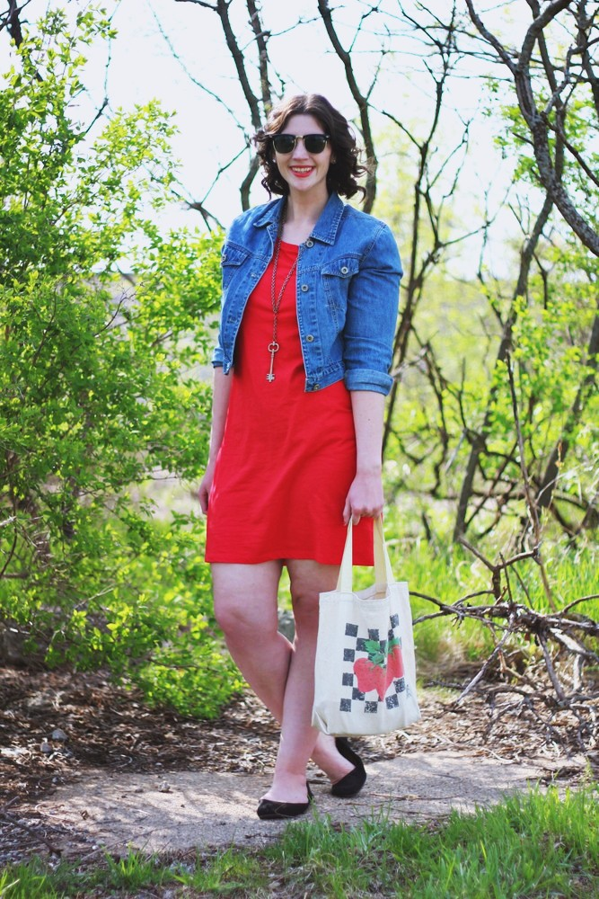 hannah rupp the outfit repeater Thrifted red dress, denim jacket, vintage strawberry tote bag.