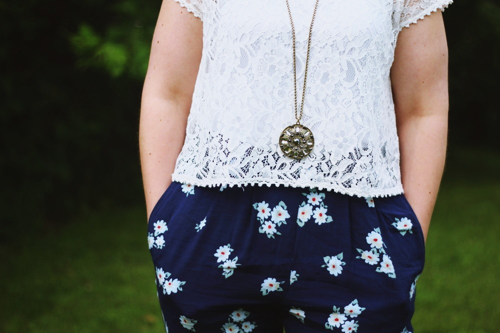 hannah rupp the outfit repeater floral high waisted pants white lace crop top summer fashion