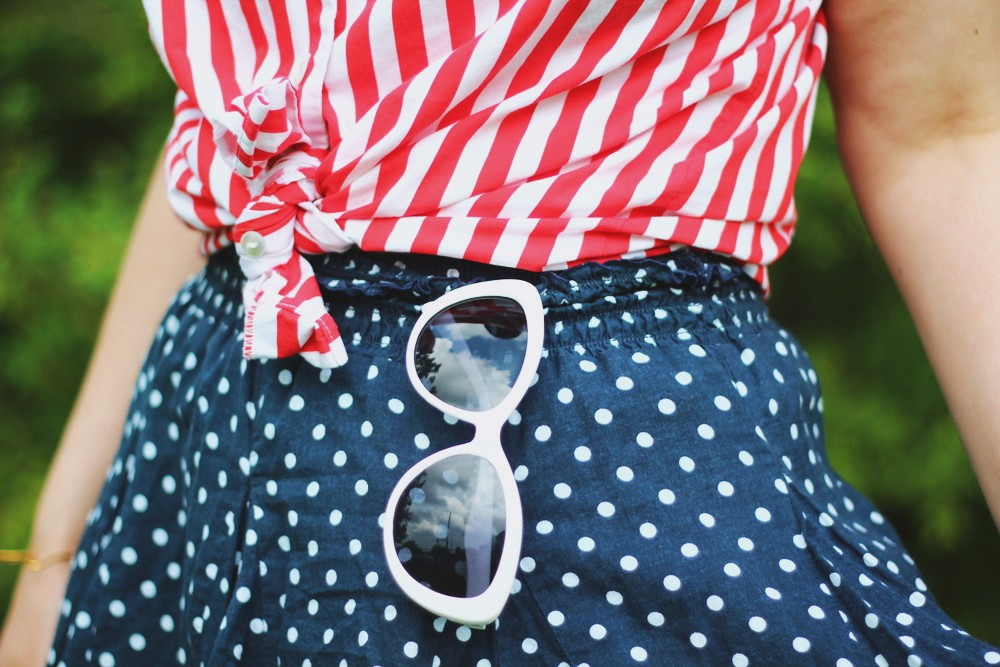 Patriotic outfit with a red striped top and blue polka dotted skirt.