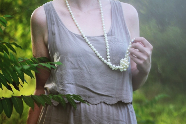 Outfit details: long faux vintage pearl necklace, beige dress