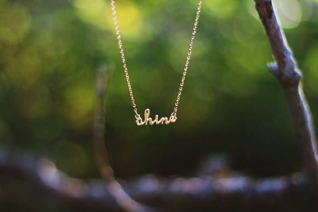 "Dainty gold necklace that says ""shine"""