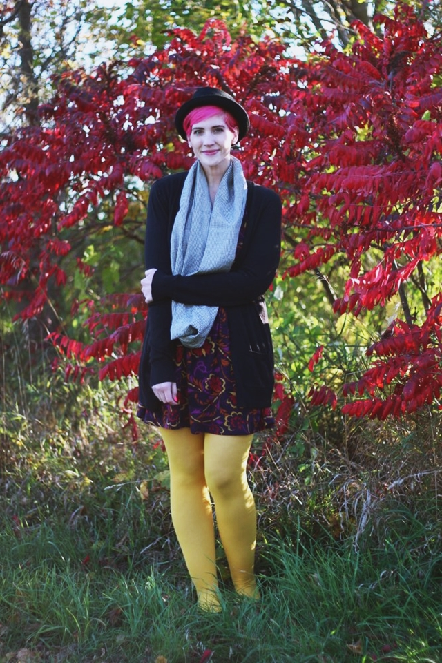 Outfit: autumn leaf print purple dress, yellow gold WeLoveColors tights, long black Wal-Mart cardigan, houndstooth infinity scarf, black ASOS pork pie hat, bright pink pixie cut