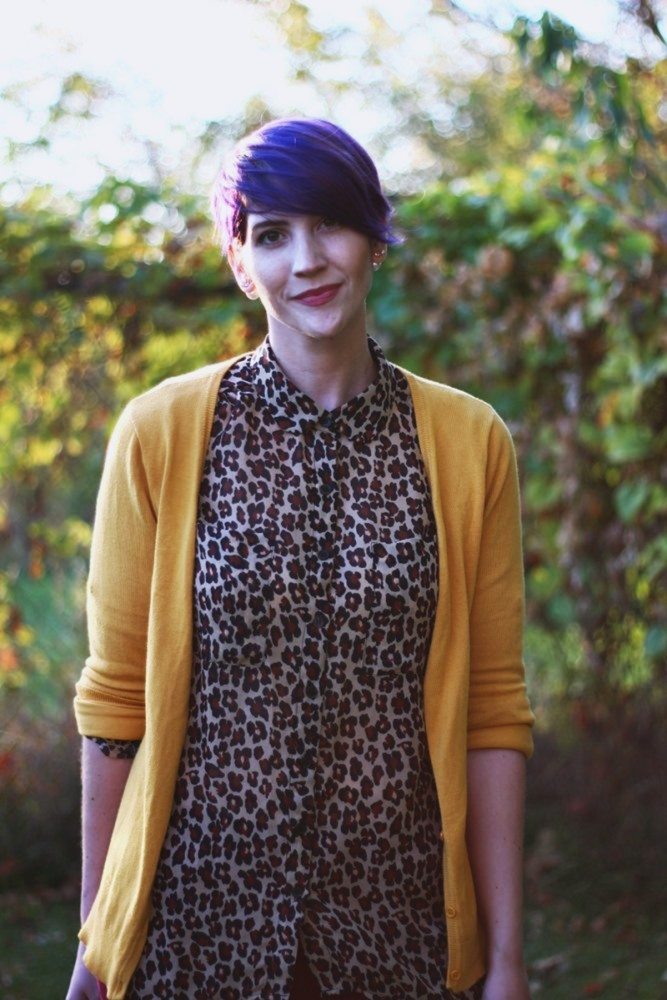Outfit details: Leopard print blouse, mustard cardigan, purple pixie hair cut