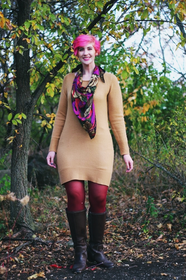 Outfit: camel colored thrifted sweater dress, burgundy maroon tights, dark brown knee high boots, purple multi-colored scarf, curly bright pink pixie cut short hair