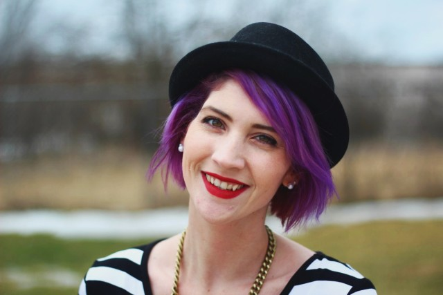 Purple hair, black hat, red lip