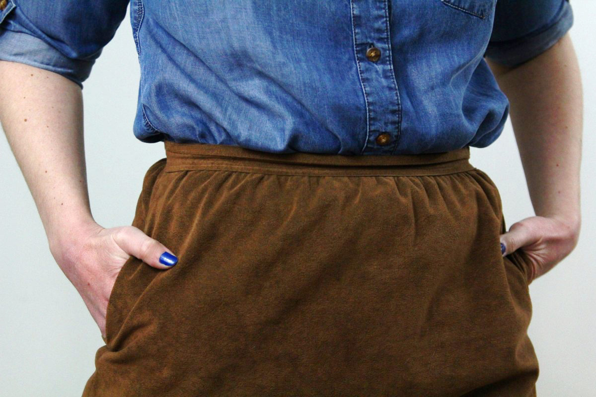 Outfit details: chambray button up and suede cognac skirt