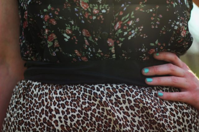 Outfit details: leopard print skirt and floral button up