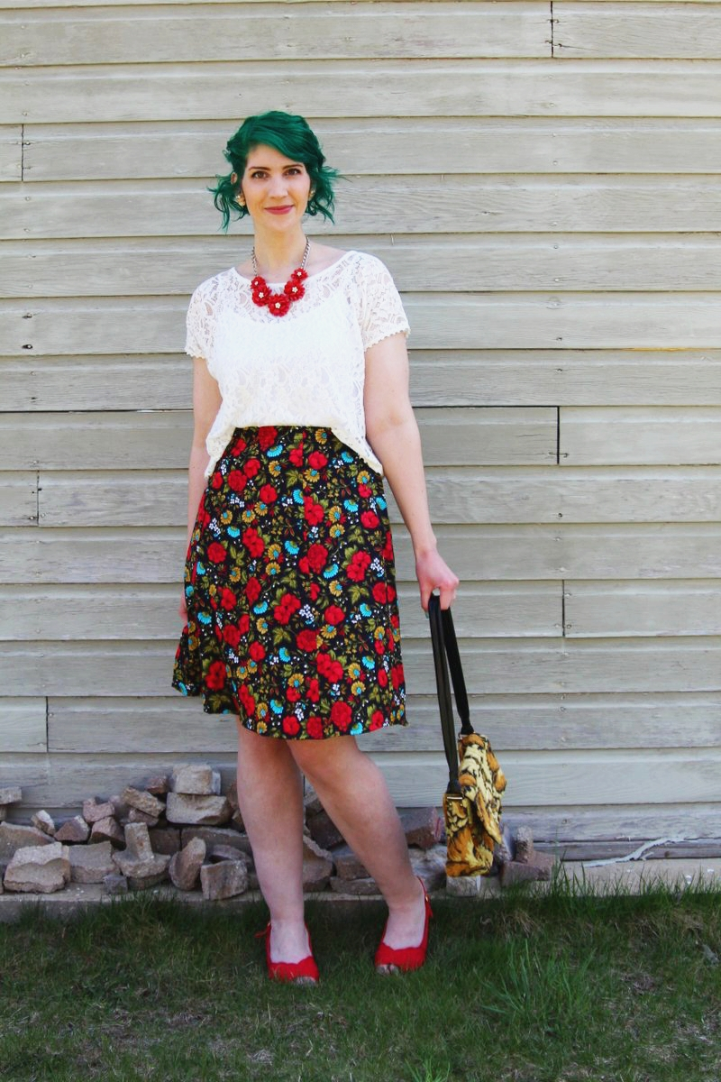 Spring style outfit: Target white lace crop top, vintage thrifted red floral skirt, thrift yellow carpet bag, red flower necklace, Punky Colours green hair, vintage red kitten heels