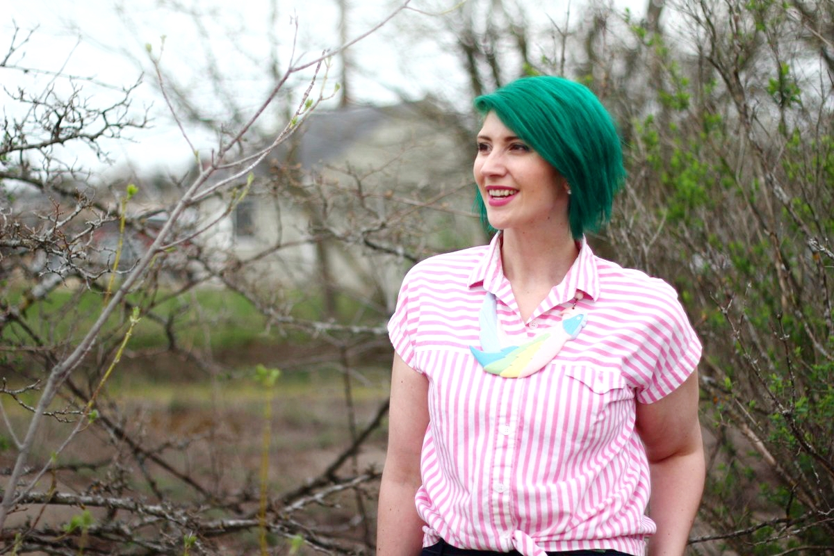 Outfit: pink striped button up, a statement necklace in the shape of a parrot, green hair