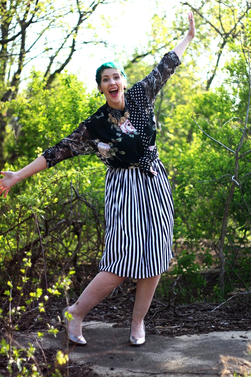 Mother's Day Outfit: Contempo Casual printed shirt, striped skirt, silver high heels, beige floral necklace, green hair