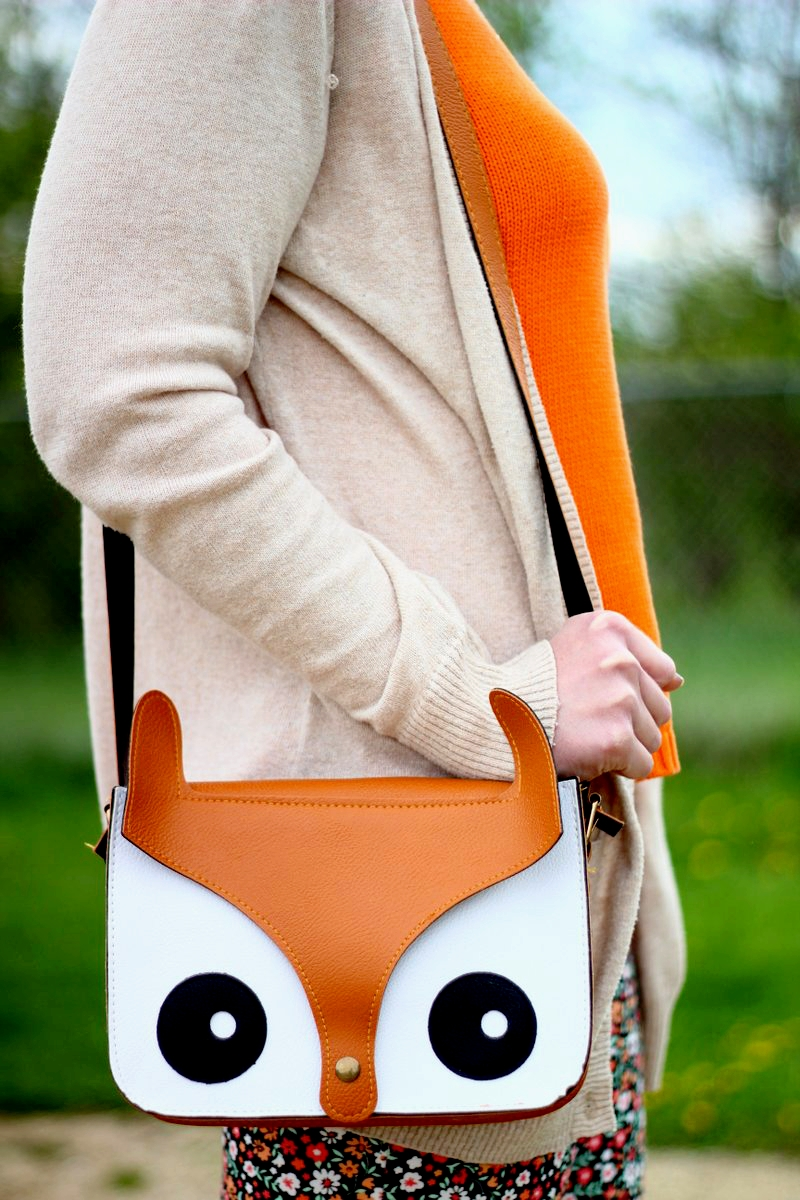Outfit details: beige cardigan, orange knit top, fox purse