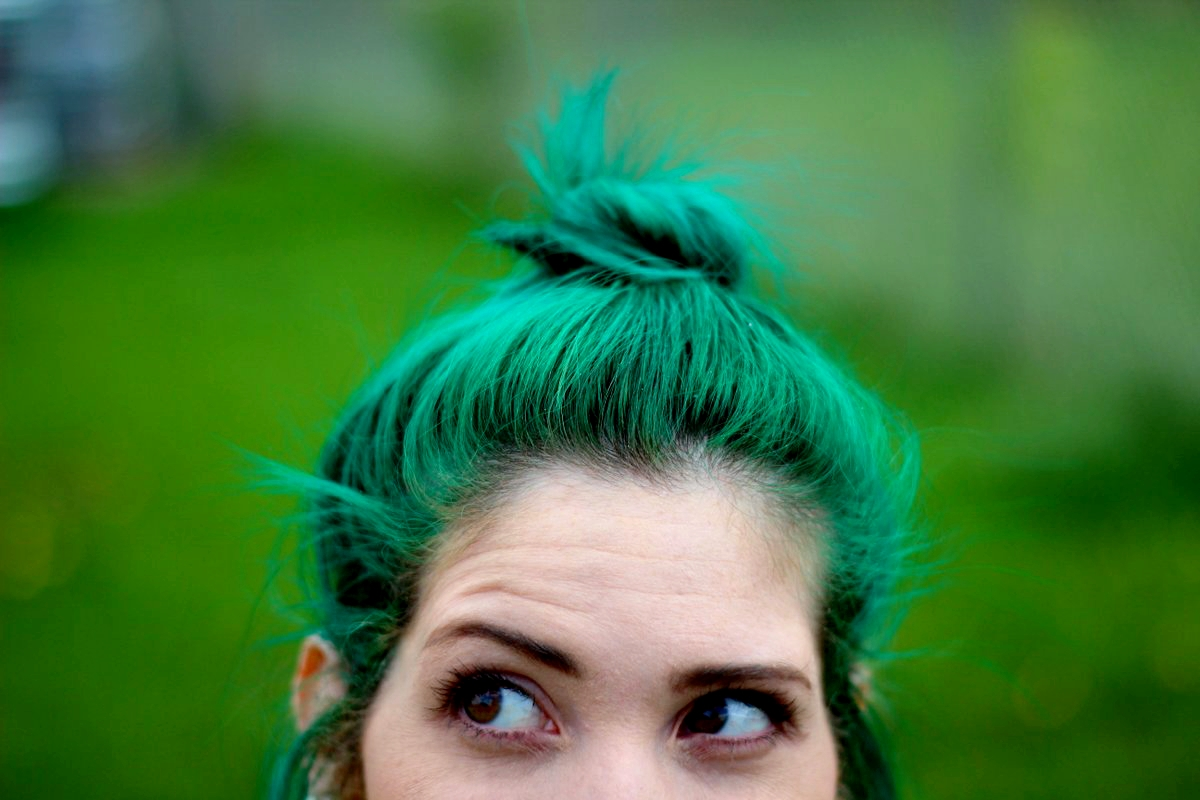 bright green hair in a mini bun hairstyle