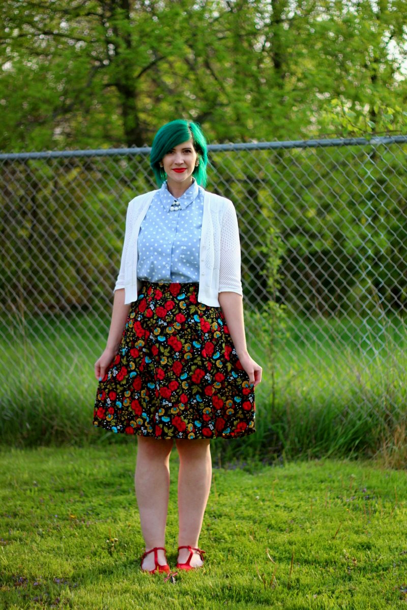 Outfit: polka dot chambray top, black floral skirt, green hair, white cardigan, vintage beaded necklace, red lips, red t-strap flat shoes