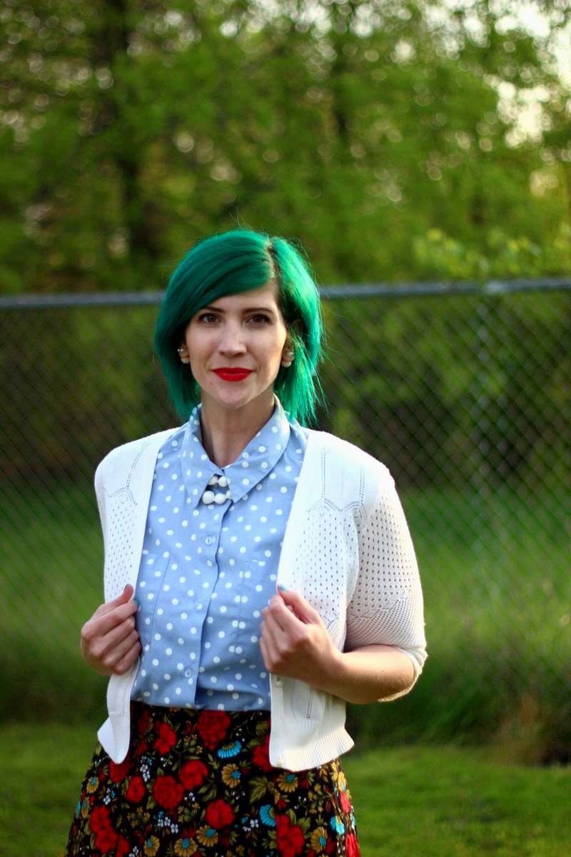 Outfit: polka dot chambray top, black floral skirt, green hair, white cardigan, vintage beaded necklace, red lips