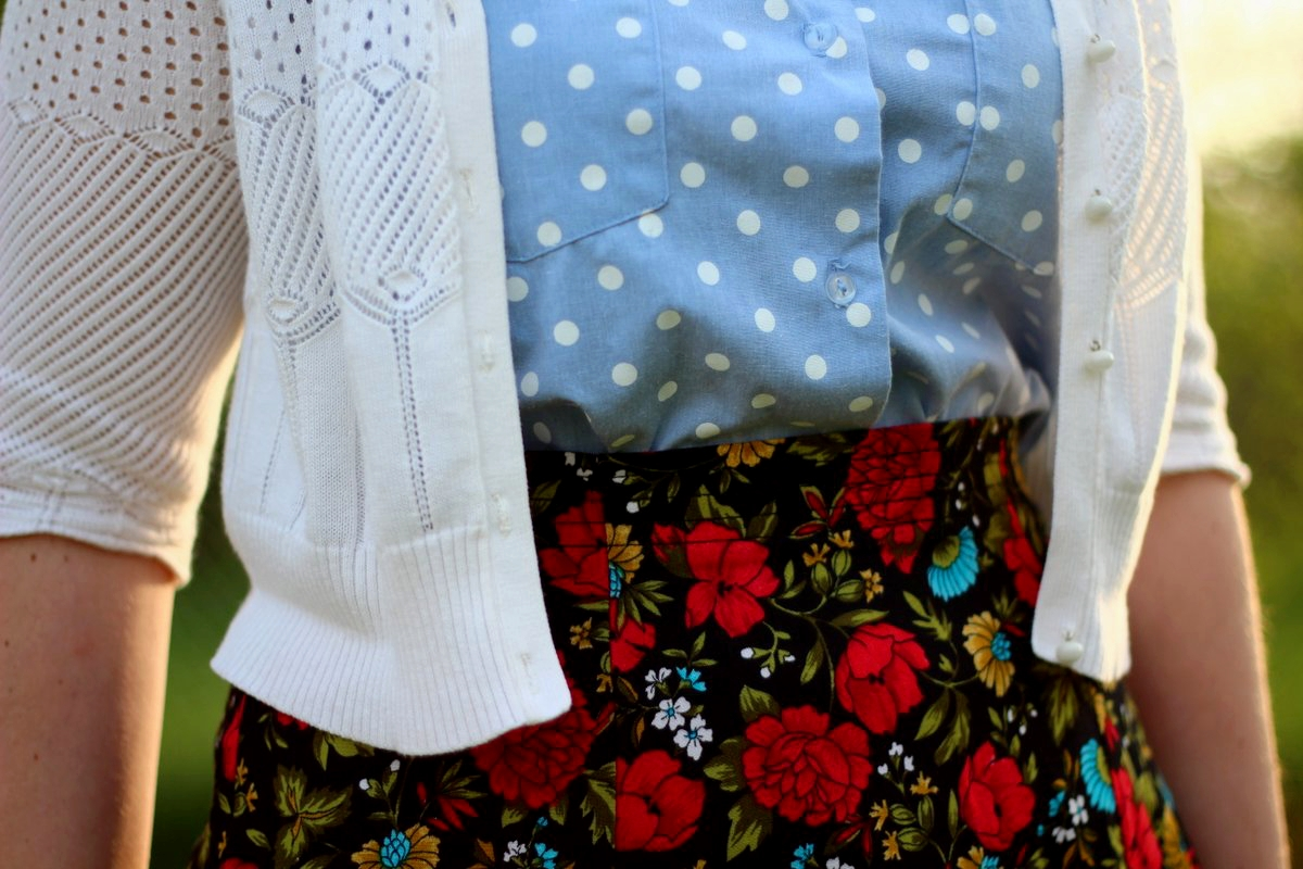 Outfit details: polka dot chambray top, black floral skirt, white cardigan