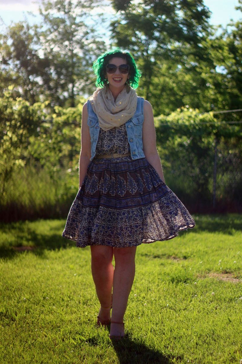Outfit: patterned summer dress, light wash denim vest, gold polka dot scarf, beige belt, sunglasses, green hair, nude kitten heels
