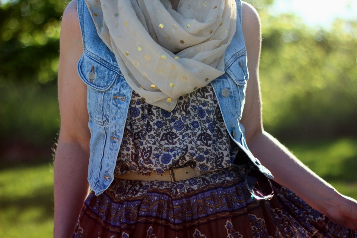 Outfit details: patterned summer dress, light wash denim vest, gold polka dot scarf, beige belt
