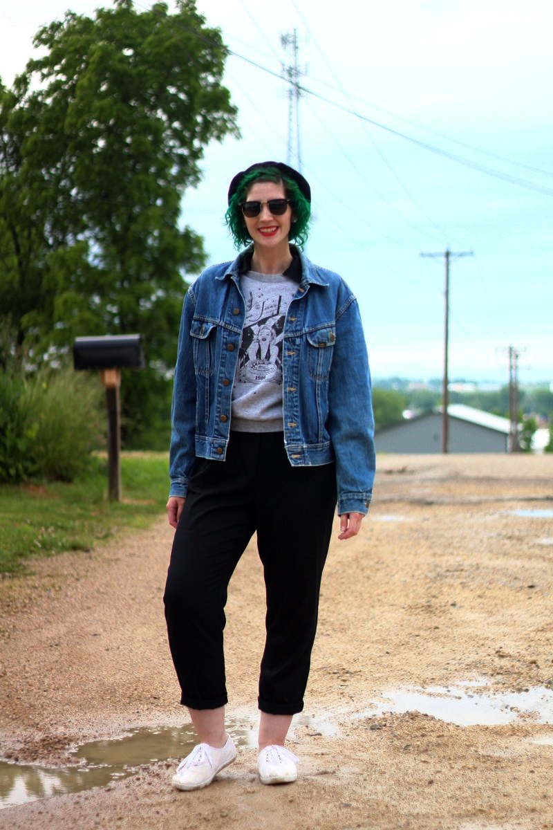 Ferris Bueller's Day Off movie inspired outfit: thrifted black jumpsuit, gray 1986 sleeveless sweatshirt, vintage denim jacket, black beret, black sunglasses, red lipstick, green hair, white sneakers