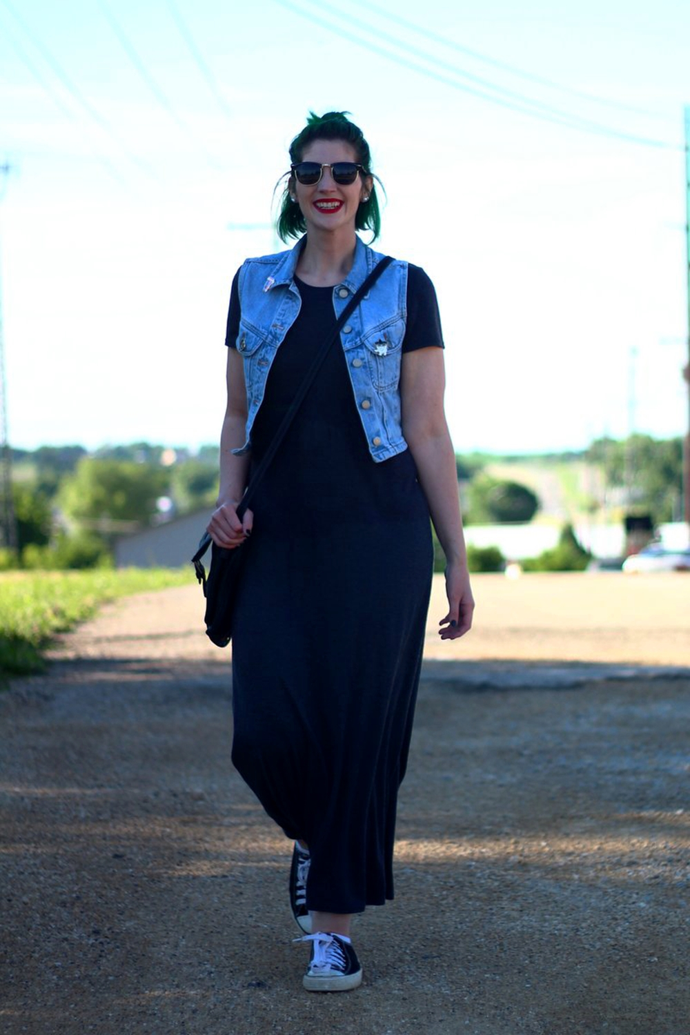 Outfit: gray ankle length maxi dress, light wash denim vest, thrifted crossbody bag, Darling Distraction enamel pins, ColourPop ultra matte lip color in Creeper, black and white sneakers