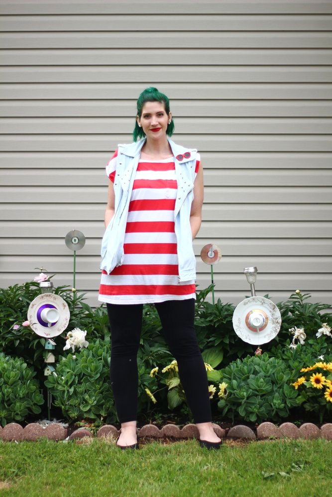 Outfit: red and white striped tunic, denim studded vest, vintage red sunglasses pin, green hair, red lipstick, black leggings, black flats