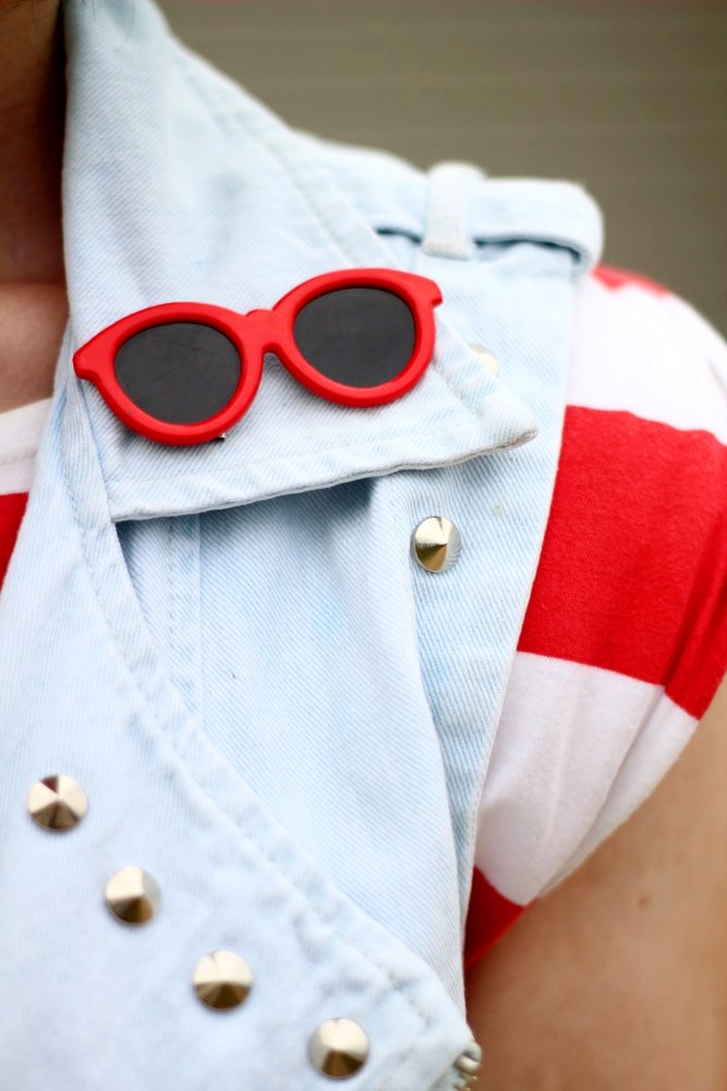 Outfit details: red and white striped tunic, denim studded vest, vintage red sunglasses pin