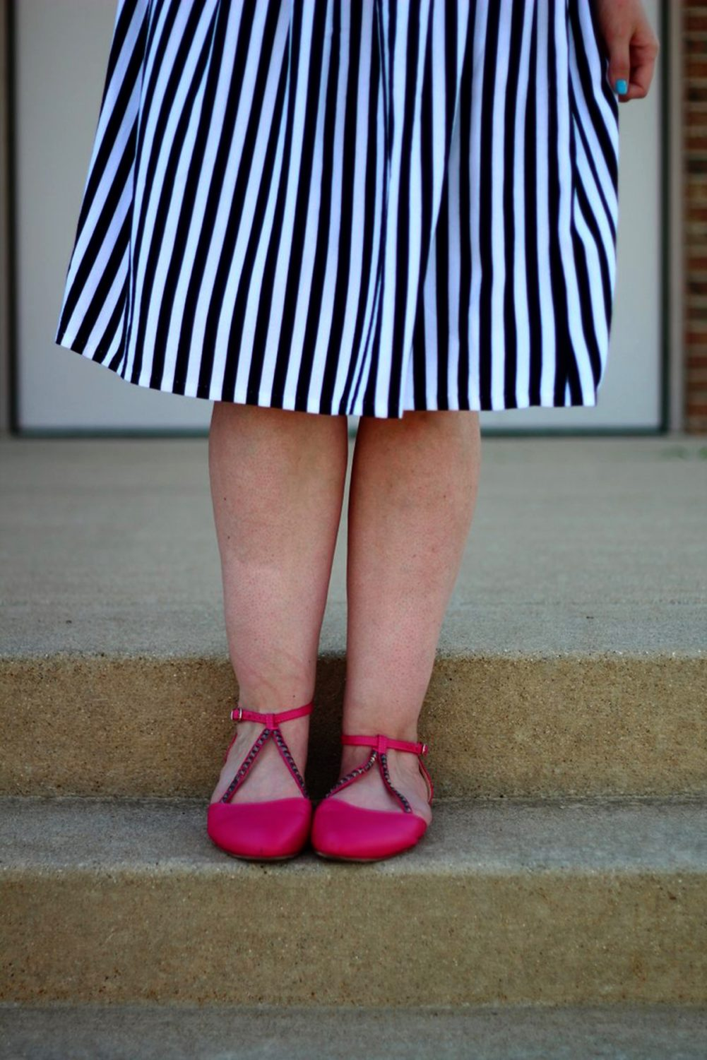 Outfit details: black and white striped skirt, pink flats.
