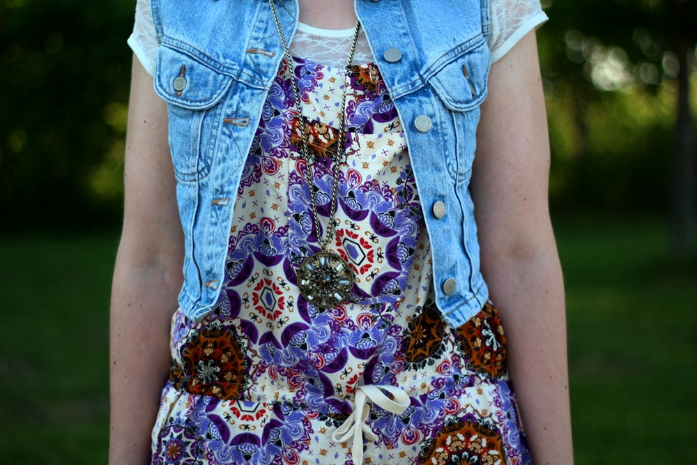 outfit details: purple boho romper overalls, light wash denim vest, white lace tee, gold oversized medallion necklace
