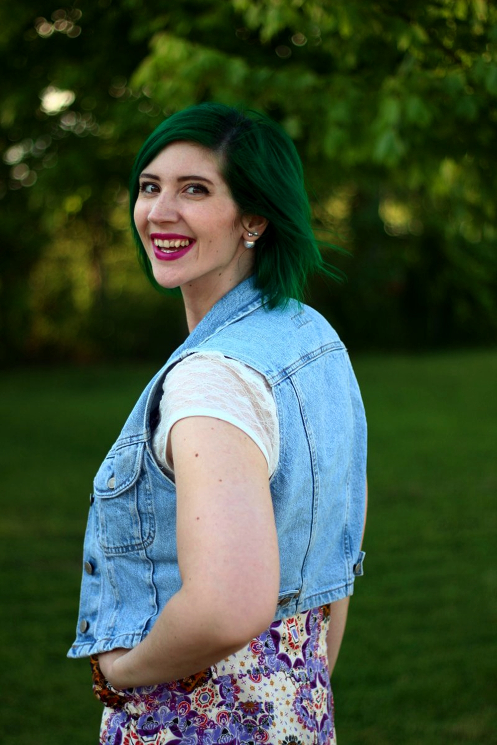 Clearly I've got this senior photo posing on lock! Outfit: purple boho romper overalls, white lace tee, light wash denim vest, green hair, purple lipstick