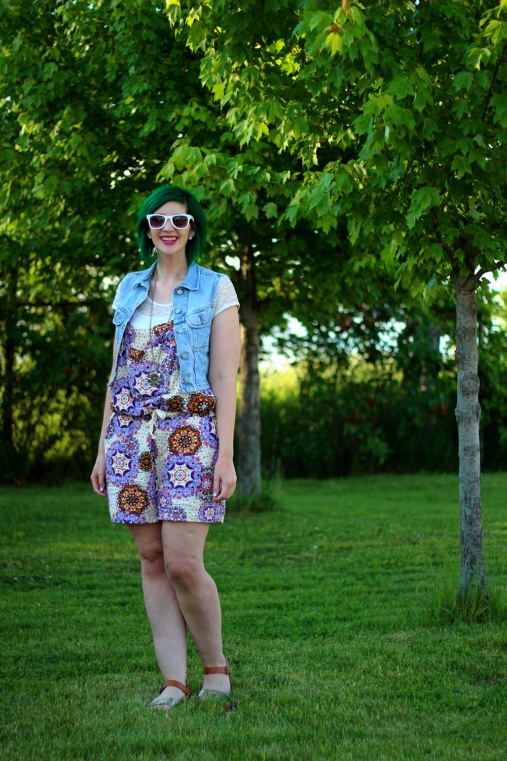 Outfit: purple boho romper overalls, white lace tee, light wash denim vest, green hair, purple lipstick, white sunglasses, Target glitter sandals