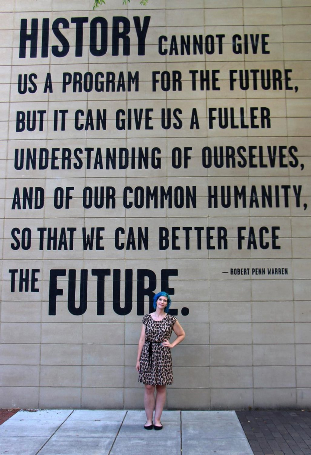Outfit: leopard print dress, sky blue curly hair, black flats, Tennessee Aquarium quote wall