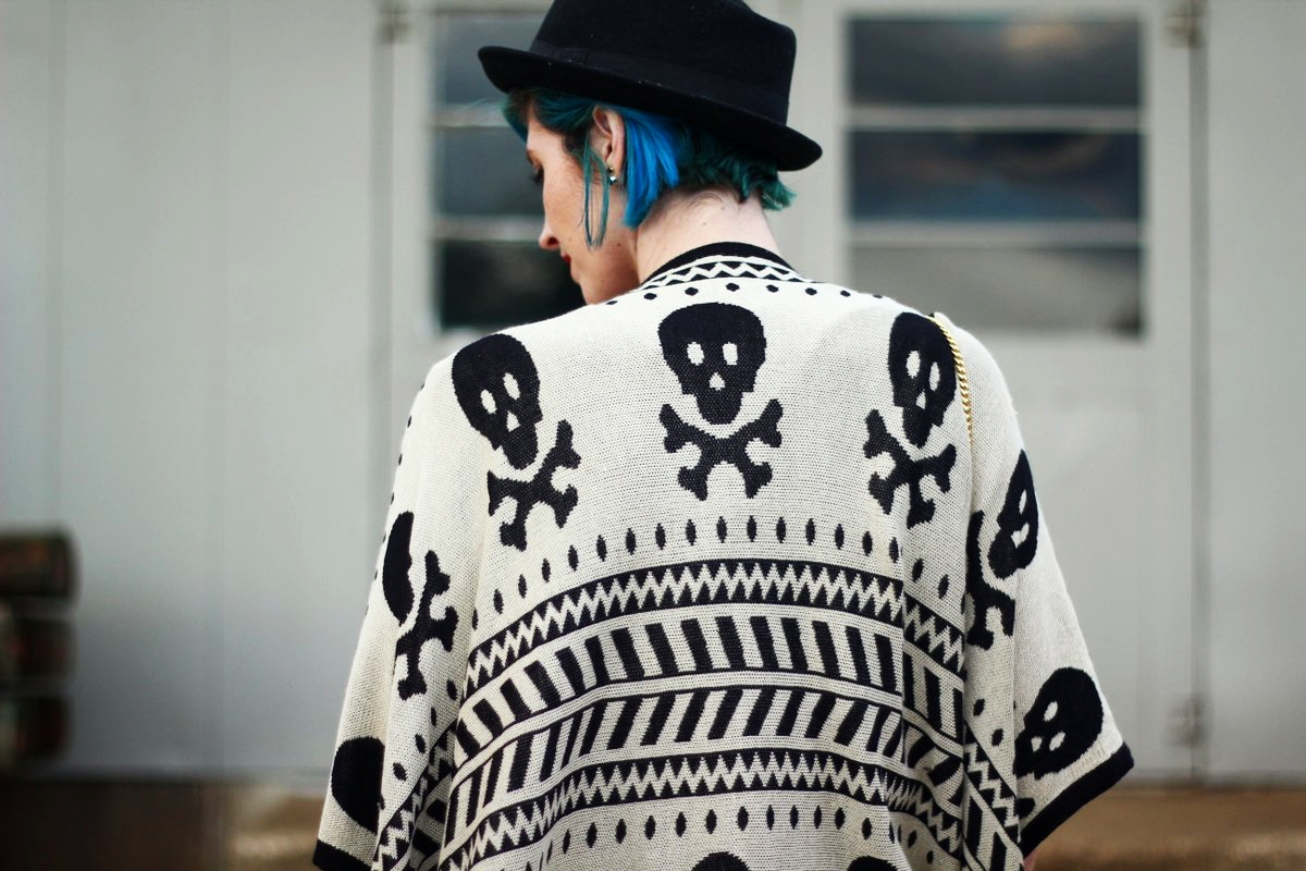 Outfit: Wearing a cardigan with a skull pattern