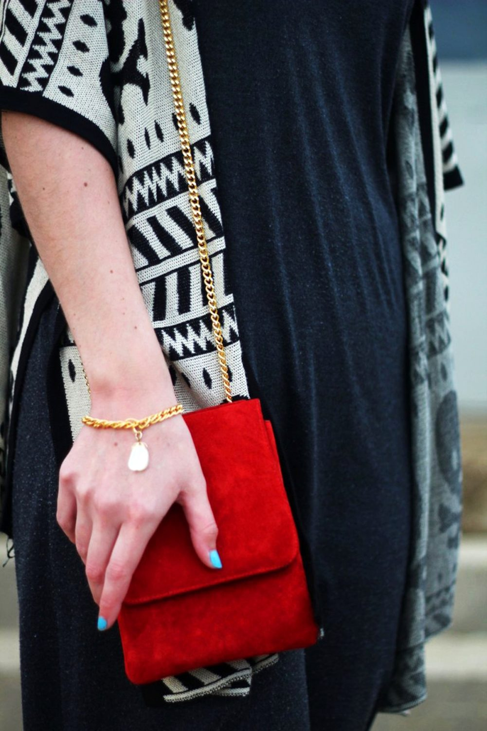 Outfit: Wearing a cardigan with a skull pattern, thrifted gray t-shirt dress, red purse