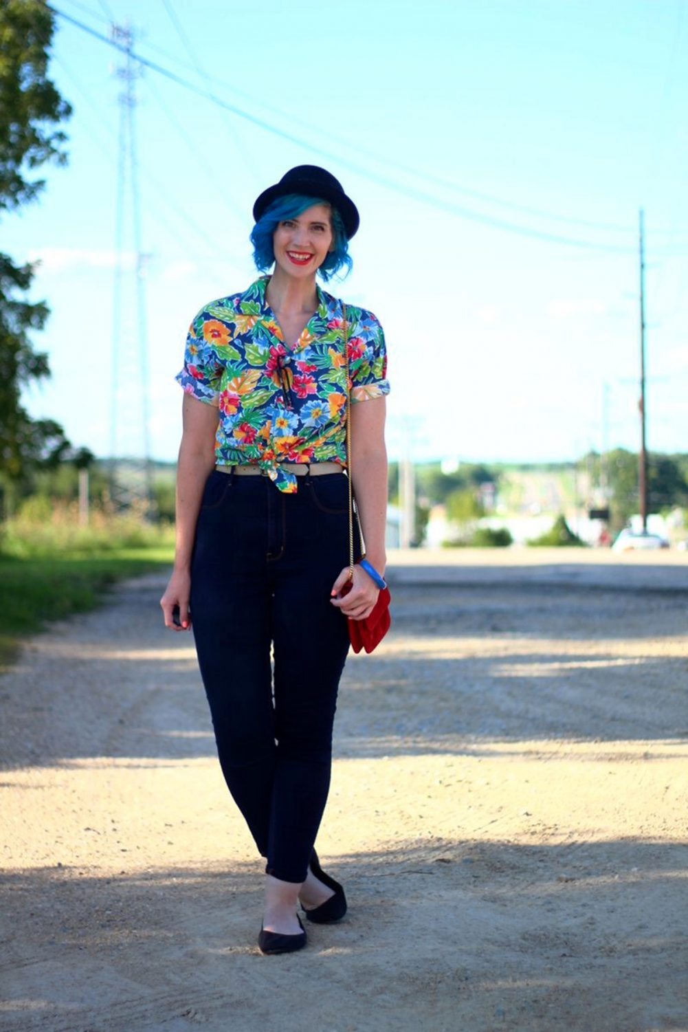 Outfit: Hawaiian print shirt, high waisted dark wash jeans, small red purse, NYX red lipstick, blue hair, black pork pie hat, black flats