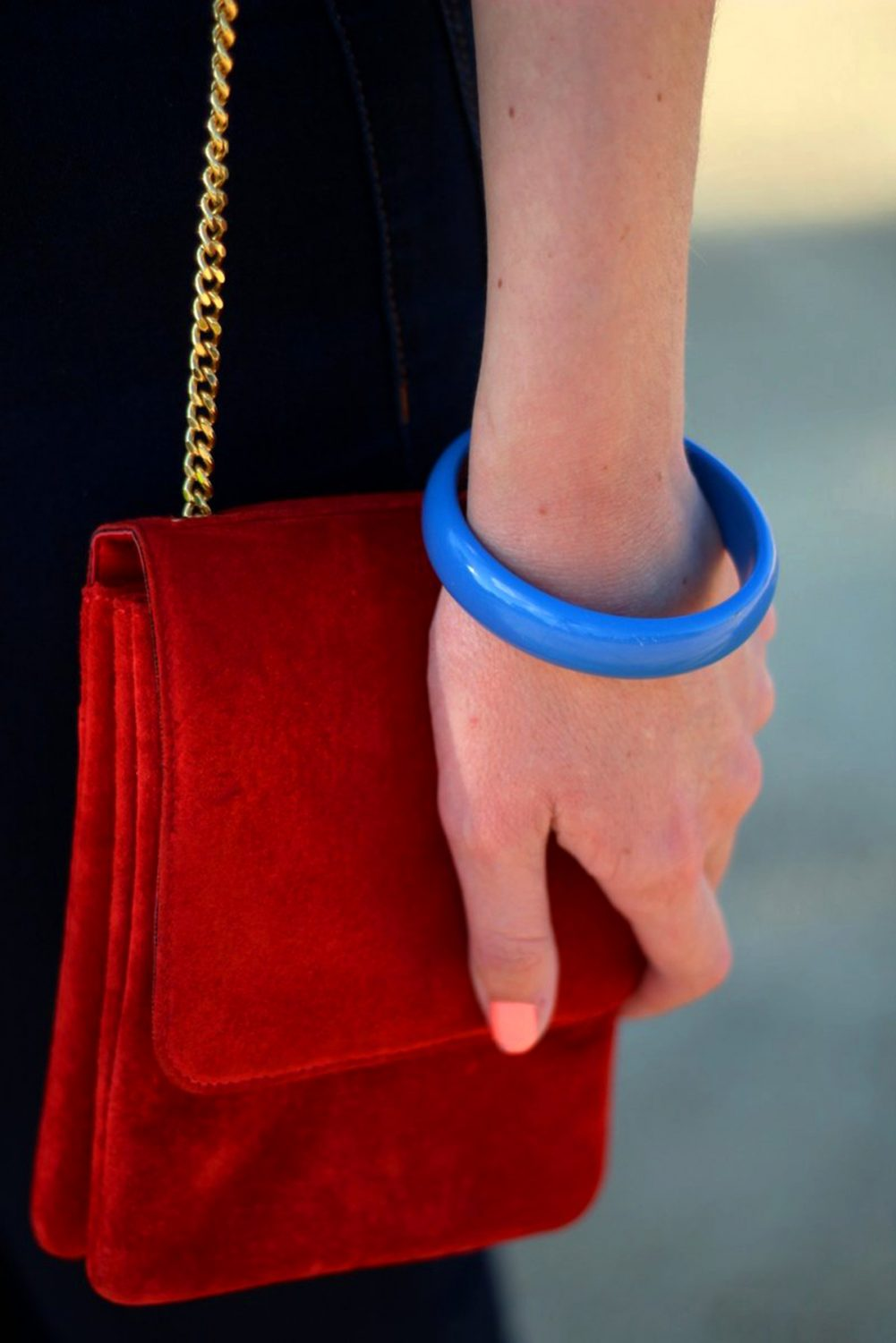 Outfit details: vintage small red suede purse with gold chain strap and blue 1980s bangle