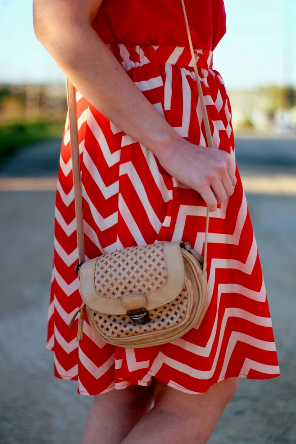 Outfit details Outfit: Vintage red top, thrifted orange chevron skirt, beige cross body purse