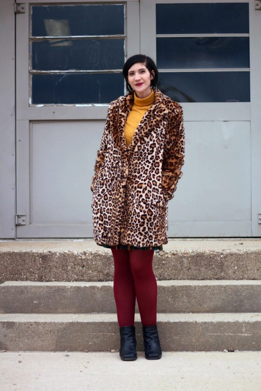 Outfit: Leopard print coat, mustard yellow turtleneck, multi colored skirt, maroon tights, black booties