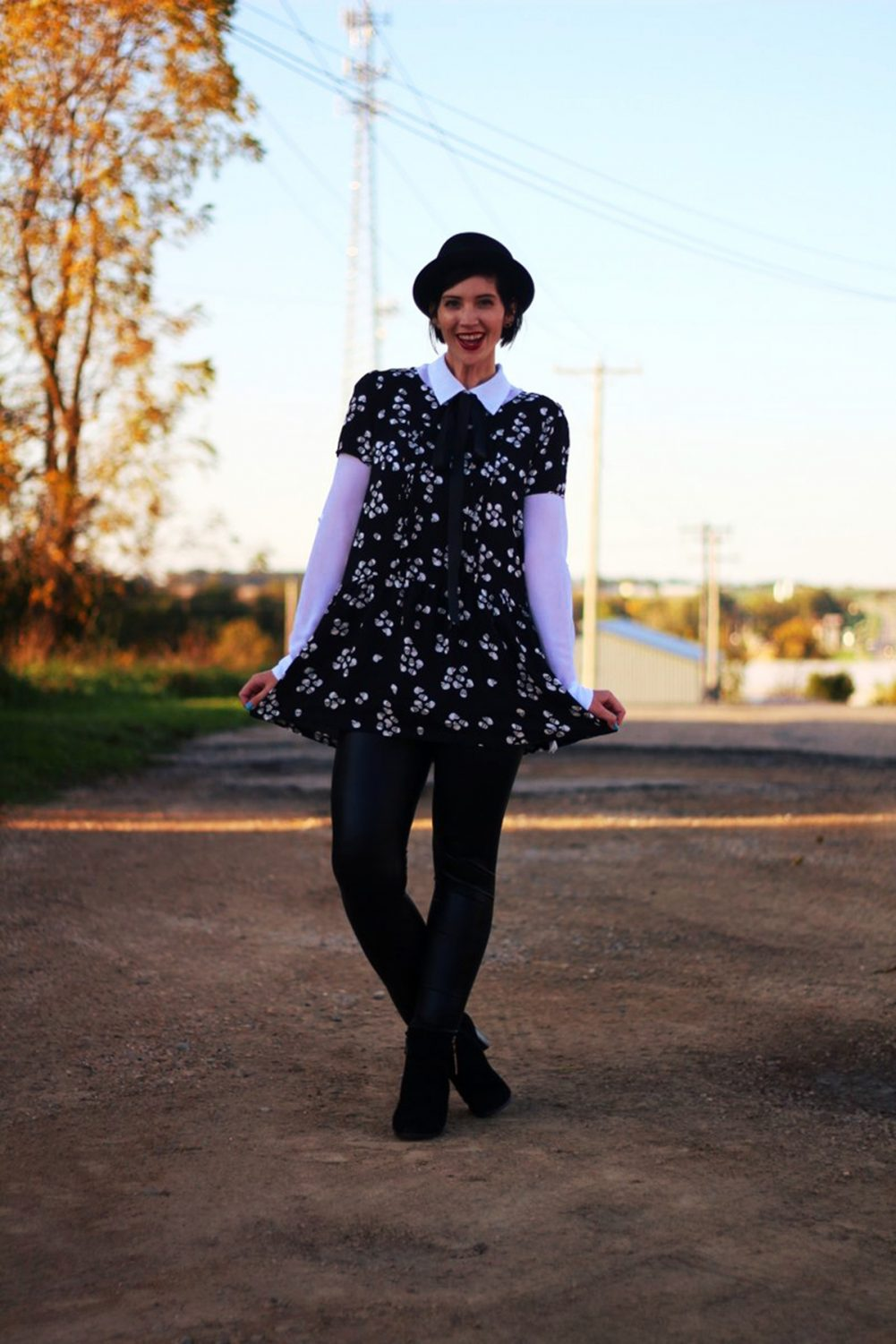 Outfit: Skull and crossbone dress, white button down, DIY ribbon, pork pie hat, dark lipstick, liquid leggings, black heeled booties