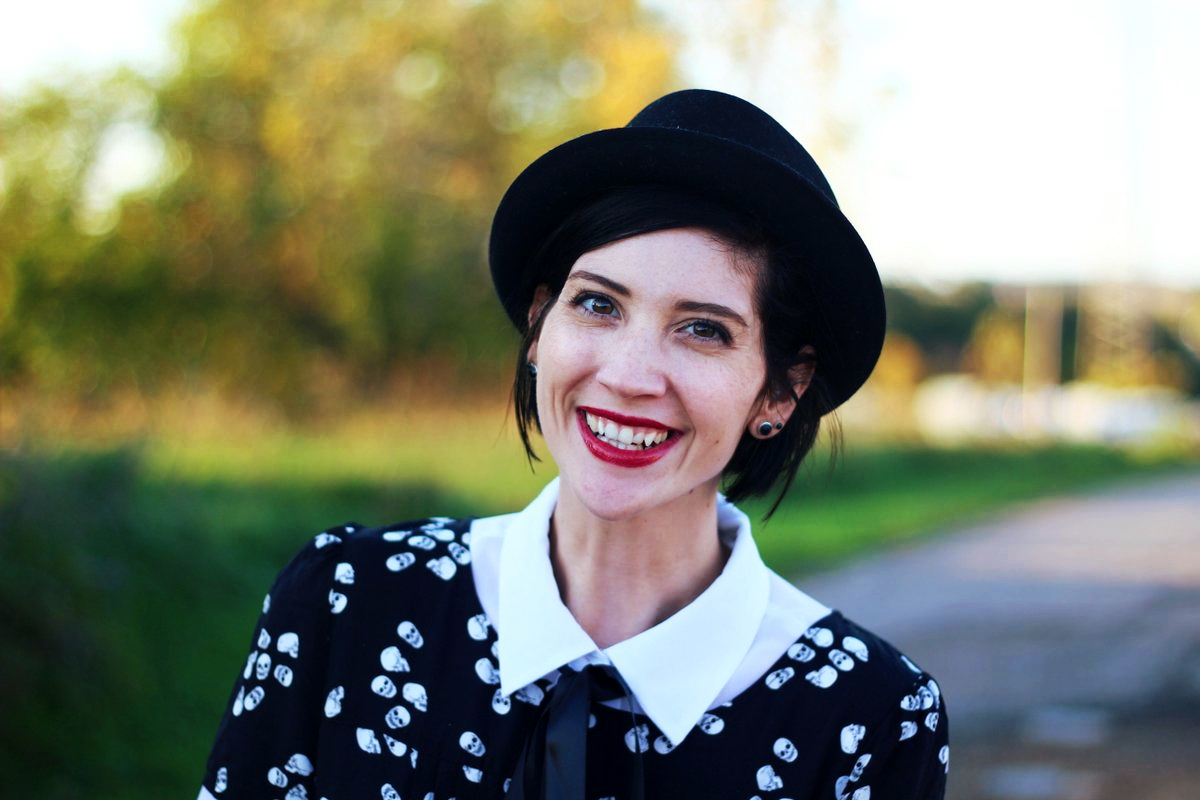 Portrait: Skull and crossbone dress, white button down, DIY ribbon, pork pie hat, dark lipstick
