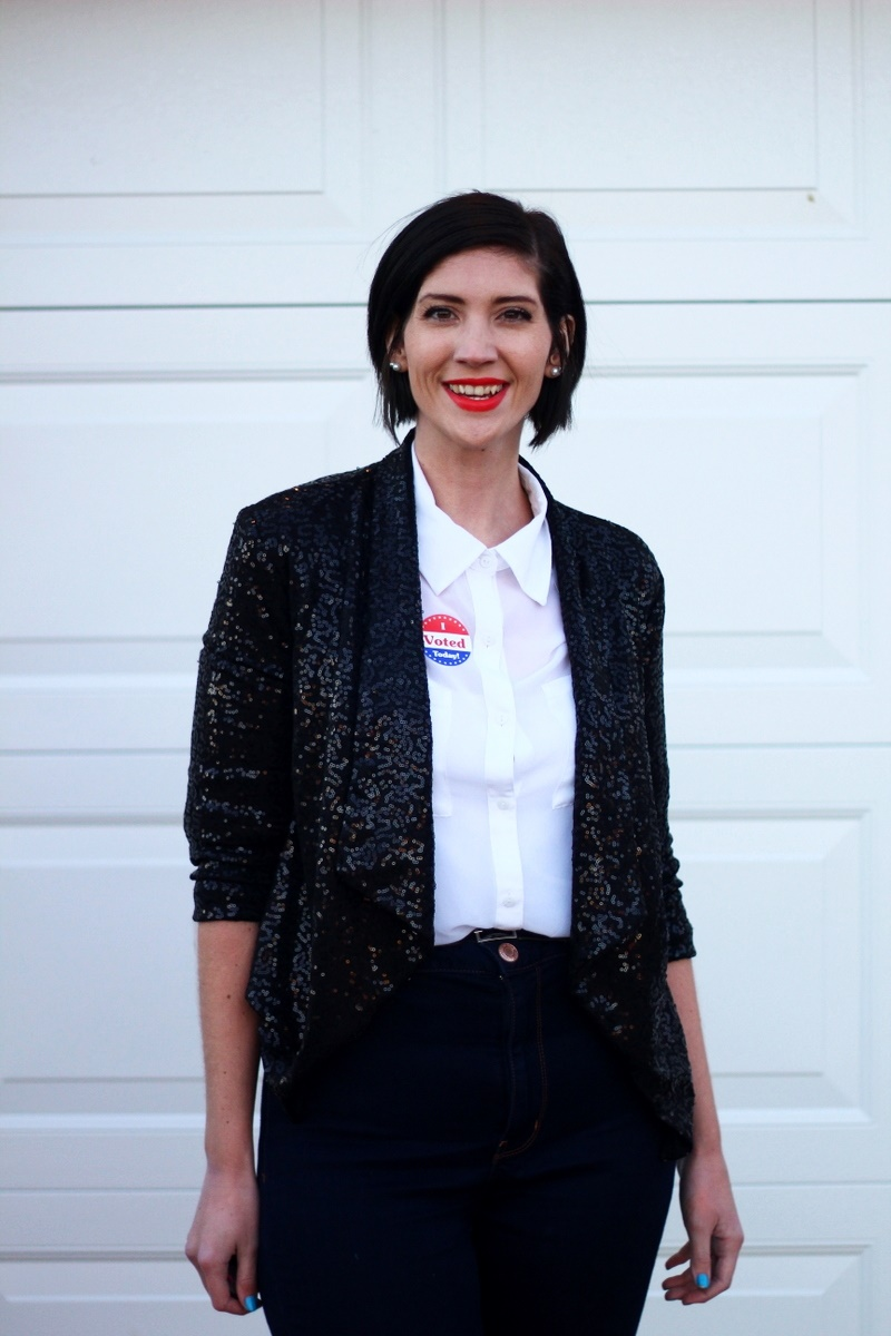 Election day outfit: white button up, red lipstick, I Voted sticker, black sequined blazer, high waisted jeans