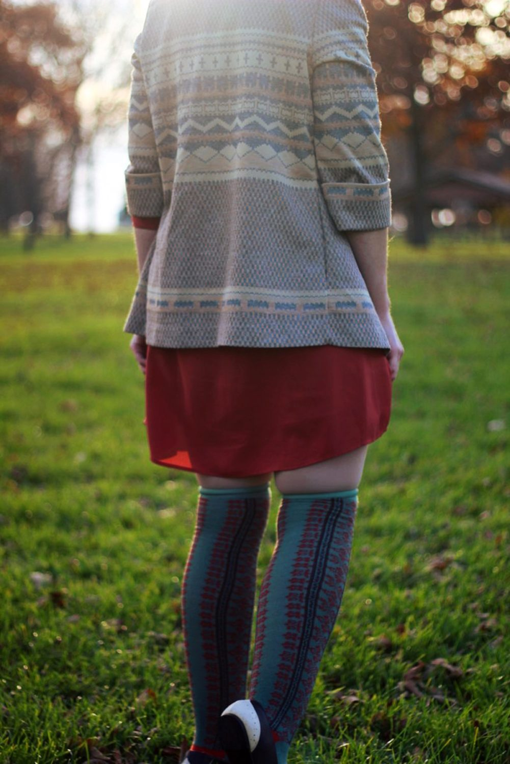 Outfit details: Orange dress, patterned cardigan, otk colorful socks