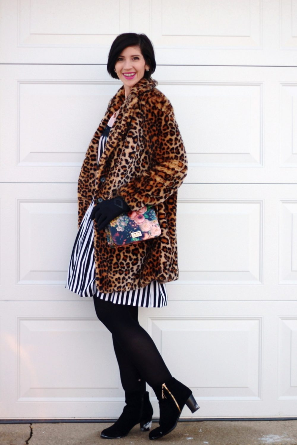Outfit: leopard print coat, cool enamel pins, graphic bow tee, black and white striped skirt, black tights, black booties, floral print purse