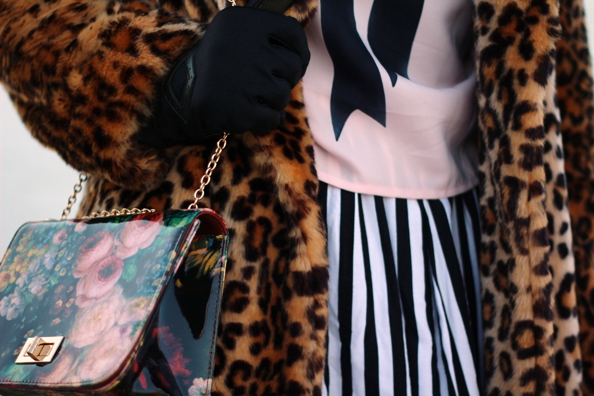 Outfit: leopard print coat, graphic bow tee, black and white striped skirt, floral print purse