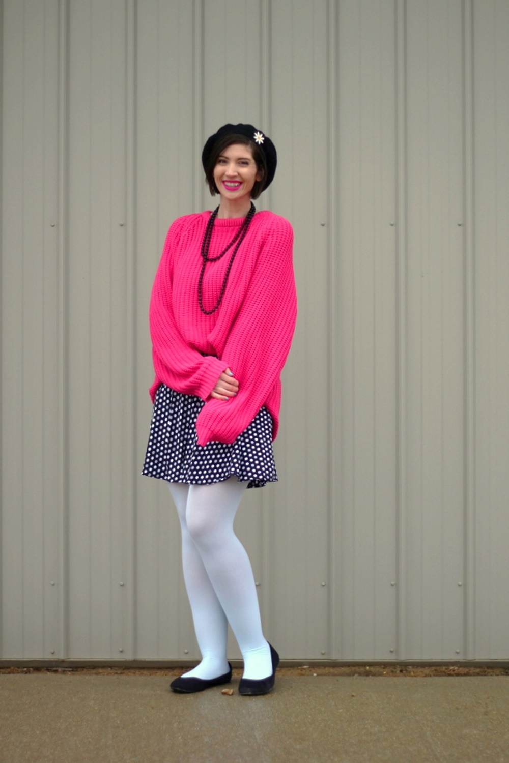Oversized pink sweater, vintage beaded necklace, black beret, daisy pin, polka dot skirt, mint blue tights, black flats