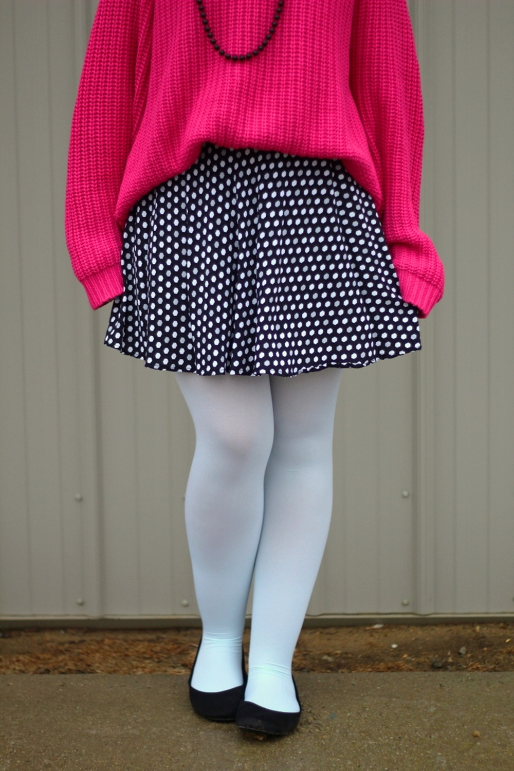 Oversized pink sweater, polka dot skirt, mint blue tights, black flats