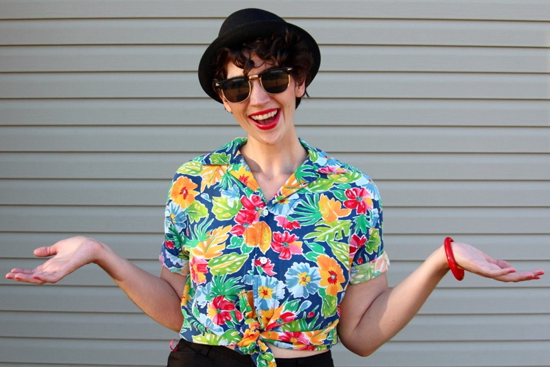 1980s outfit Hawaiian Print Shirt, high waisted shorts, red kitten heels, pork pie hat, red lipstick, sunglasses, bangle